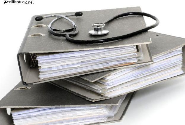 Звіт про справу: Дворівневий розміщення штучного диска для лікування спондилотичної мієлопатії шийки матки
